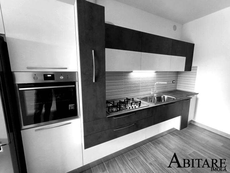 interior design cucina moderna piano hpl antracite bianco effetto resina arredare casa bologna medicina budrio castenaso oikos cucine