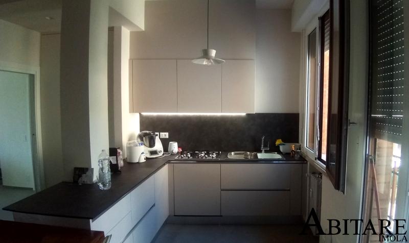 oikos cucine cucina moderna penisola top hpl anta liscia senza maniglia ozzano emilia san lazzaro bologna arredare casa home design luci led jpg
